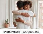 pleased dark skinned young... | Shutterstock . vector #1239008551
