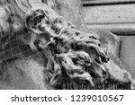sculpture of dead on plague... | Shutterstock . vector #1239010567