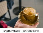 a cup of coffee in the hand of... | Shutterstock . vector #1239021841