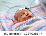 hearing test of a sleeping... | Shutterstock . vector #1239038947