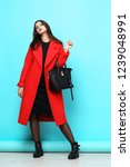 fashion woman in red coat.... | Shutterstock . vector #1239048991