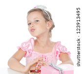 Small photo of Funny little princess girl in silver crown and pink dress over white