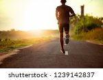 athlete runner feet running on... | Shutterstock . vector #1239142837