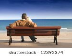 Couple On Wooden Bench Looking...