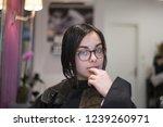 brunette girl with glasses | Shutterstock . vector #1239260971