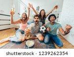 happy friends or football fans... | Shutterstock . vector #1239262354