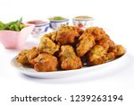 isolated side view of pakoda or ... | Shutterstock . vector #1239263194