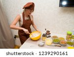 young beautiful woman cook in... | Shutterstock . vector #1239290161