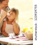 father and daughter on picnic | Shutterstock . vector #123929755