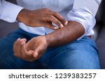 close up of an african man... | Shutterstock . vector #1239383257