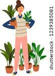 girl holding indoor plants pots ... | Shutterstock .eps vector #1239385081