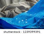 water drops on waterproof blue... | Shutterstock . vector #1239399391