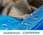water drops on waterproof blue... | Shutterstock . vector #1239399394