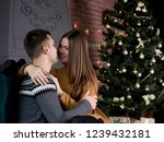young married couple is sitting ... | Shutterstock . vector #1239432181