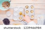 scooping blueberry muffin... | Shutterstock . vector #1239466984