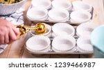 scooping blueberry muffin... | Shutterstock . vector #1239466987