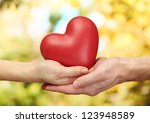 red heart in woman and man... | Shutterstock . vector #123948589