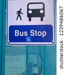 bus stop sign on side of bus... | Shutterstock . vector #1239486067