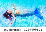 young mermaid floating in pool... | Shutterstock . vector #1239499621