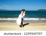 bride and groom at the beach ...   Shutterstock . vector #1239545707