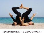 girls practice acro yoga in... | Shutterstock . vector #1239707914