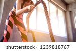 woman training with battle rope ... | Shutterstock . vector #1239818767