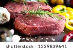 raw beef steak on a dark wooden ... | Shutterstock . vector #1239839641