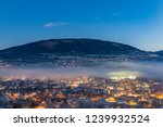 stratus clouds over voss town.... | Shutterstock . vector #1239932524