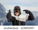 Skier Pointing On His Helmet In ...