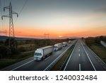 four white lorry trucks convoy... | Shutterstock . vector #1240032484