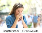 ill woman blowing on a paper... | Shutterstock . vector #1240068931