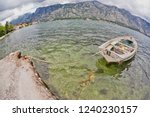 the old boat in the sea with...   Shutterstock . vector #1240230157