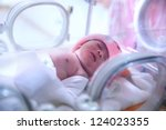 newborn baby in hospital post... | Shutterstock . vector #124023355