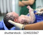 newborn baby in labor room | Shutterstock . vector #124023367