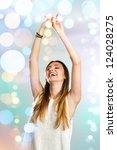 Attractive young woman dancing with festive color background. - stock photo
