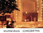 white decorated fireplace near... | Shutterstock . vector #1240289794