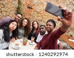 group of diverse young friends... | Shutterstock . vector #1240292974