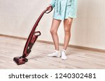 a woman in a blue robe cleans... | Shutterstock . vector #1240302481