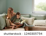 young mother  read a book to...   Shutterstock . vector #1240305754