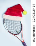santa hat on tennis racket on... | Shutterstock . vector #1240315414