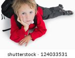 Portrait Of Young Boy Lying On...