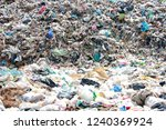 Small photo of Mountain garbage, large and degraded garbage pile, Pile of stink and toxic residue, waste plastic bottles and other types of plastic waste site in trash dump or landfill. Pollution concept.