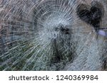 Small photo of Broken glas gunshot black heart