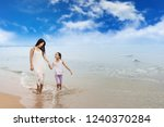 family on the beach.happy... | Shutterstock . vector #1240370284
