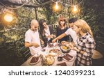 happy friends having fun eating ... | Shutterstock . vector #1240399231