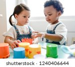little kids playing toys at... | Shutterstock . vector #1240406644