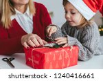 gift wrapping. cute little girl ... | Shutterstock . vector #1240416661