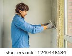master is applying white putty... | Shutterstock . vector #1240448584