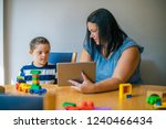 mother teaching son from a... | Shutterstock . vector #1240466434