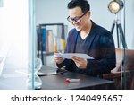 asian businessman receive a... | Shutterstock . vector #1240495657